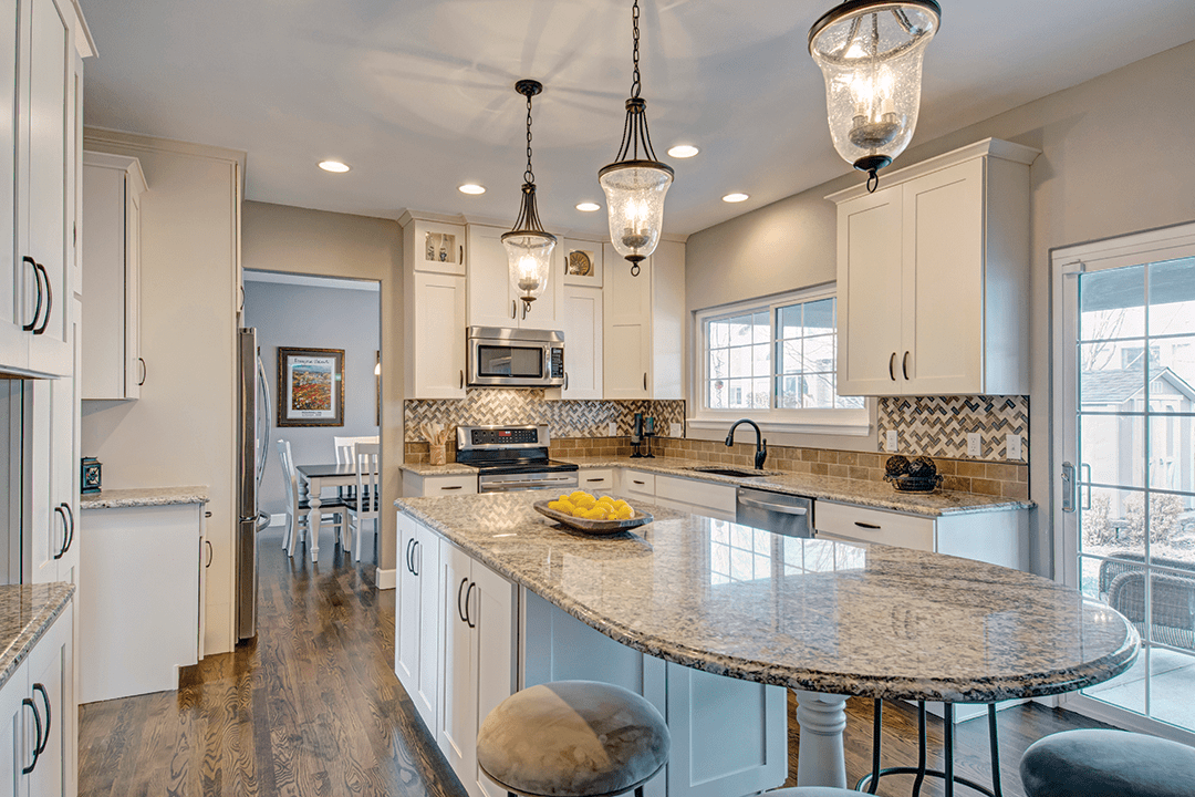 remodeled kitchen | white marble open floor plan