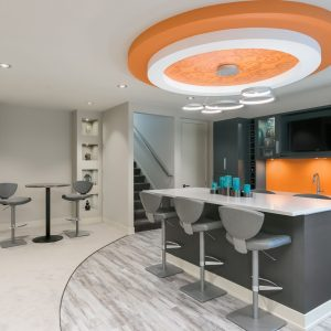 basement remodel with orange accents and colorful design | rosenthal design | fbc remodel