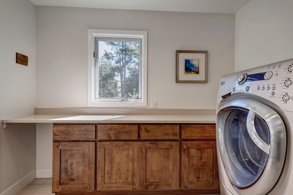 Laundry room with wood and white | whole house remodel naperville