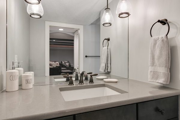 bathroom with marble counter and bronze accents minneapolis