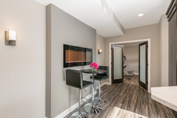 hallway in basement remodel with hightop table | basement remodel minneapolis