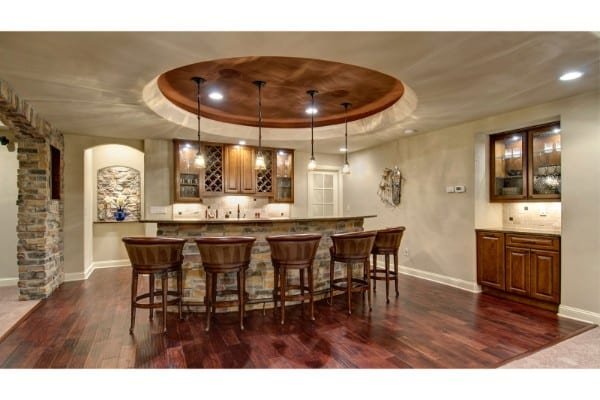 basement remodel with traditional wood and stone accents | fbc remodel
