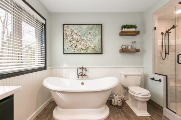 bathroom remodel with shower bench and wood floors