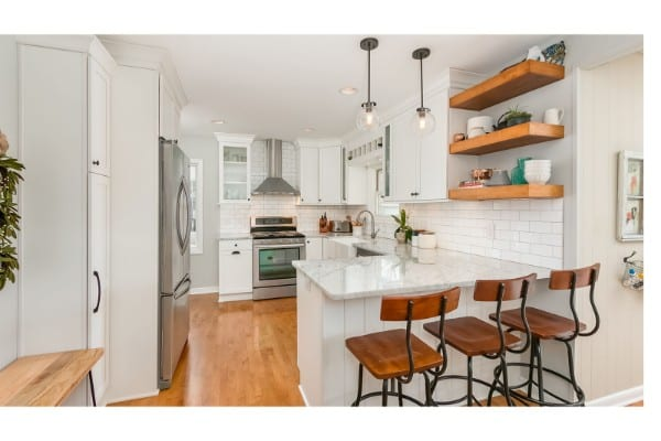 kitchen remodel with white cabinets and open wood shelving