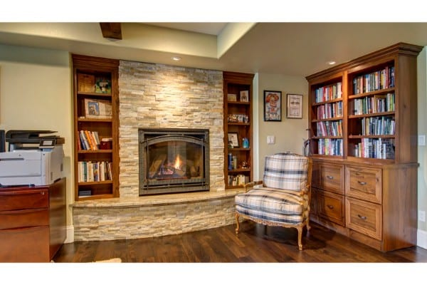 basement remodel | traditional wood with stone wall