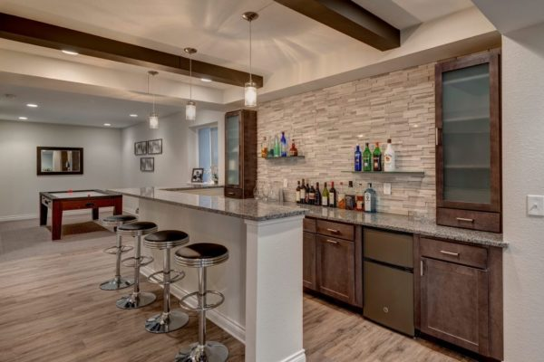 basement remodel with wet bar and wood accents | fbc remodel