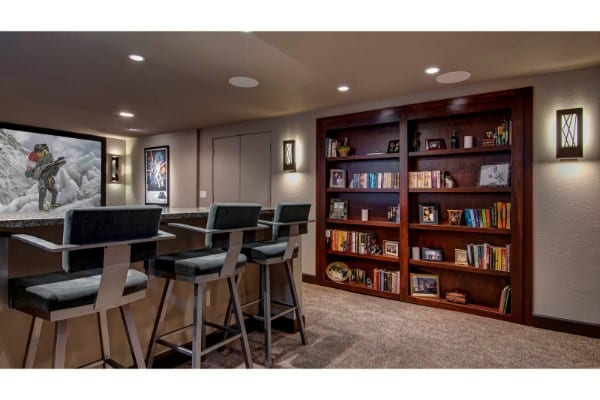 basement remodel with home theater and bookcase door | fbc remodel