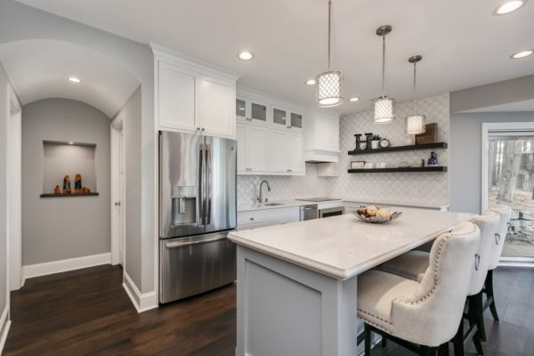 kitchen remodel with open shelving and white finishes