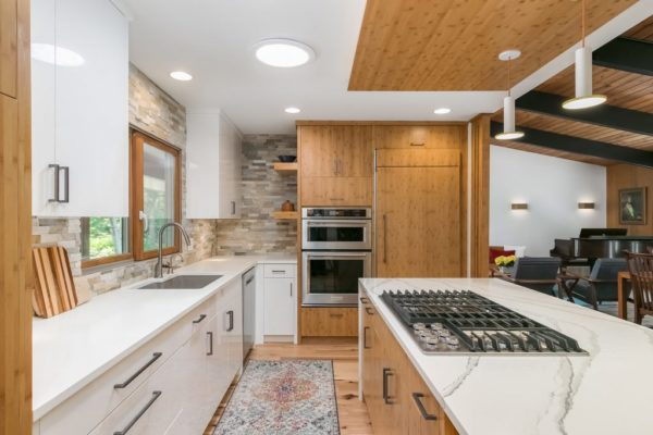 kitchen remodel with wood cabinets and accents