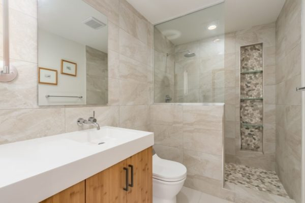 bathroom remodel with wood cabinets and finishes