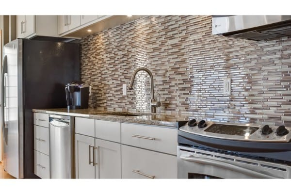 kitchen remodel with classic design and stone backsplash
