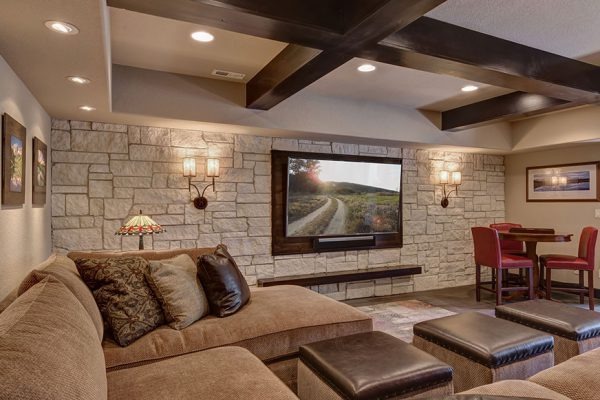 basement remodel with home theater and expowsed wood beams