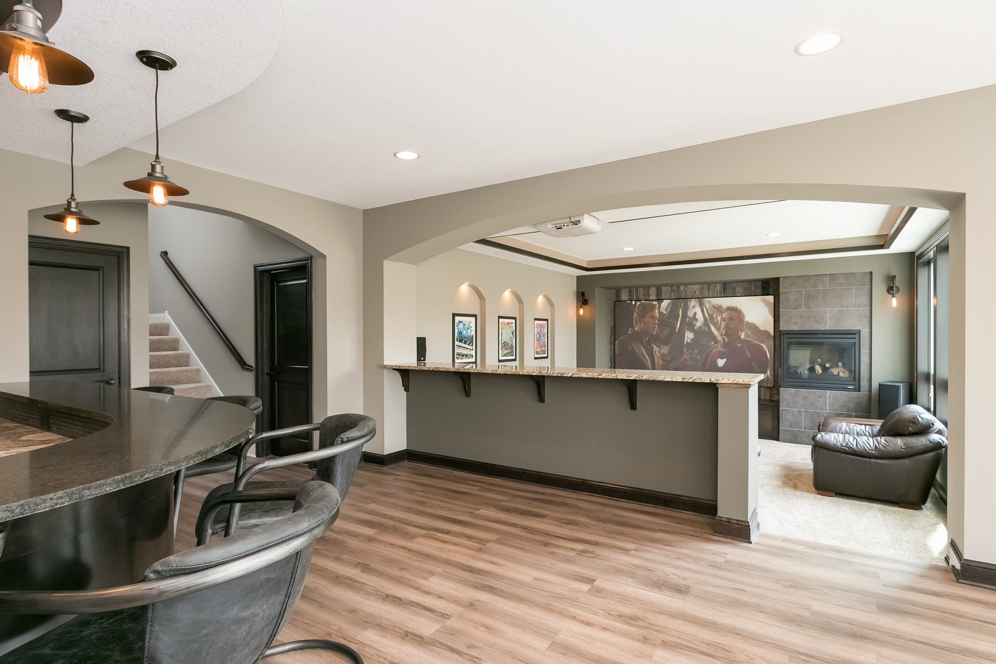 basement remodel with wet bar and home theater