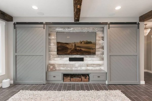 basement remodel | home theater with sliding barn doors | fbc remodel