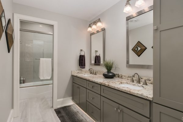bathroom remodel with gray cabinets and shower room