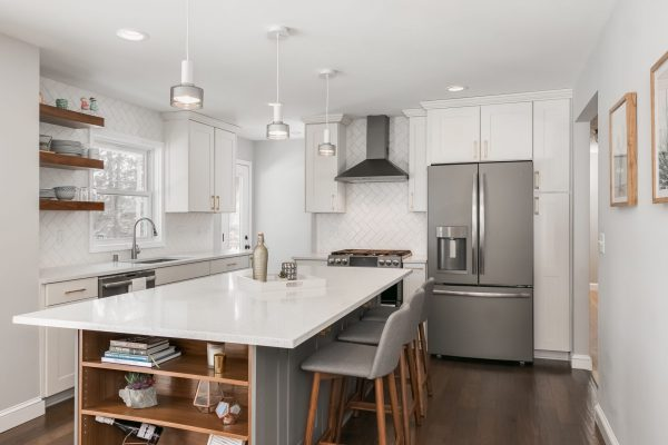 kitchen remodel with white cabinets and island