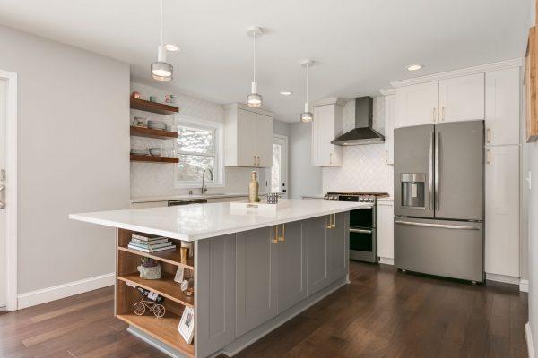 kitchen remodel   gray kitchen island, white cabinets, stainless steel appliances