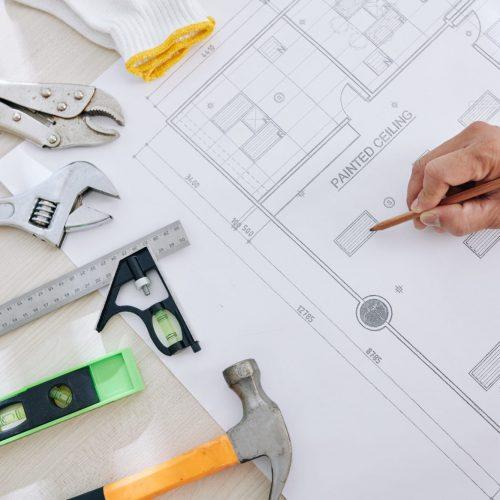 engineer-checking-house-blueprint-ELFPYHZ-scaled.jpg